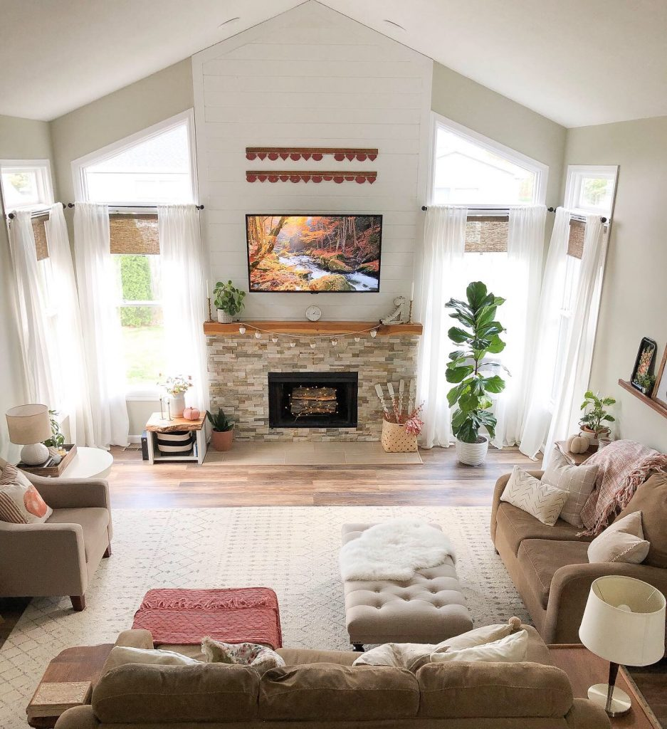 Fixer upper inspired fireplace makeover stacked stone live edge shiplap modern farmhouse
