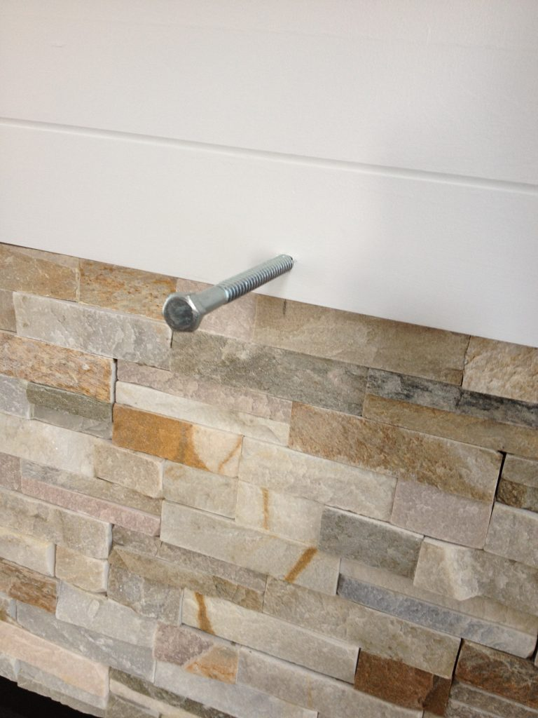 stacked stone bolts to attach mantel