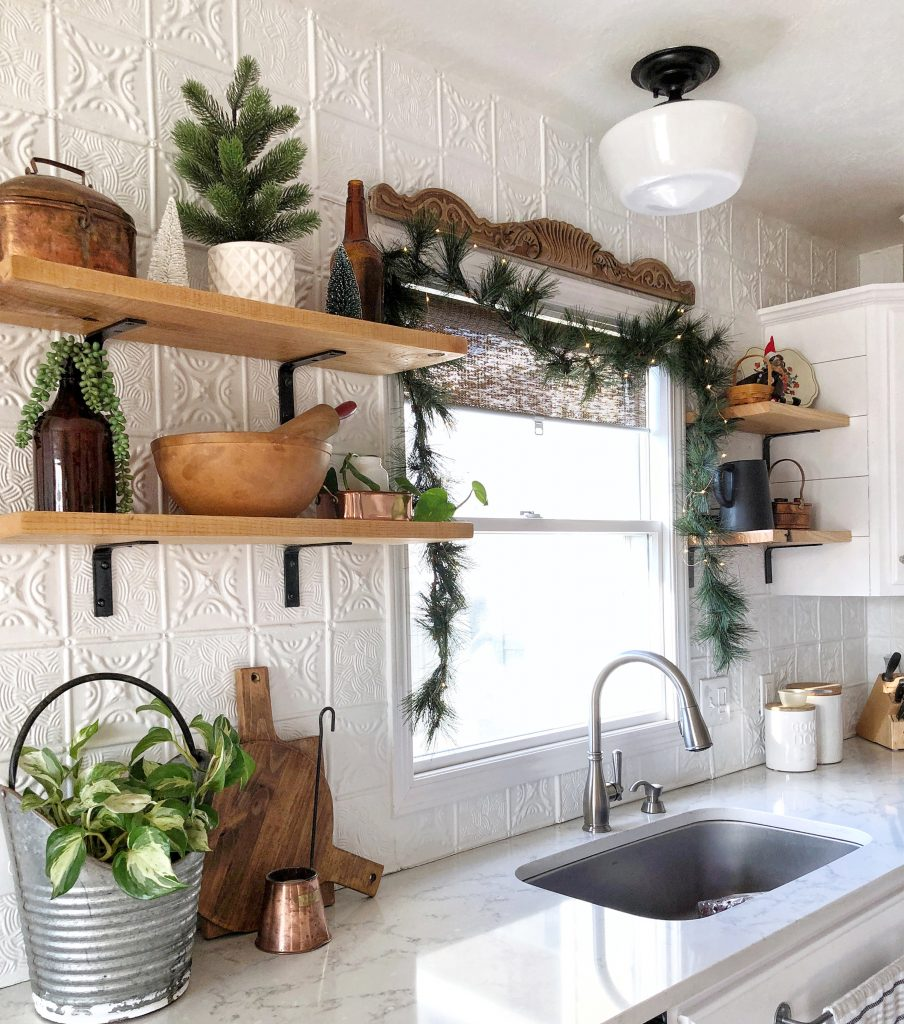 Add greenery and twinkle lights fir Christmas decor Modern Farmhouse Kitchen.